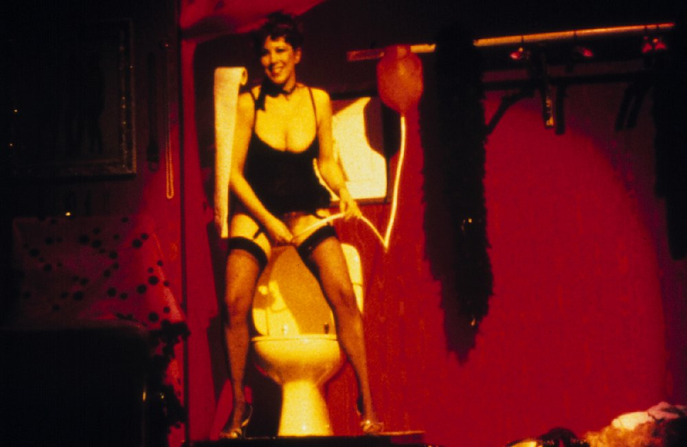 annie sprinkle giving herself an enema or douche during her performance art show