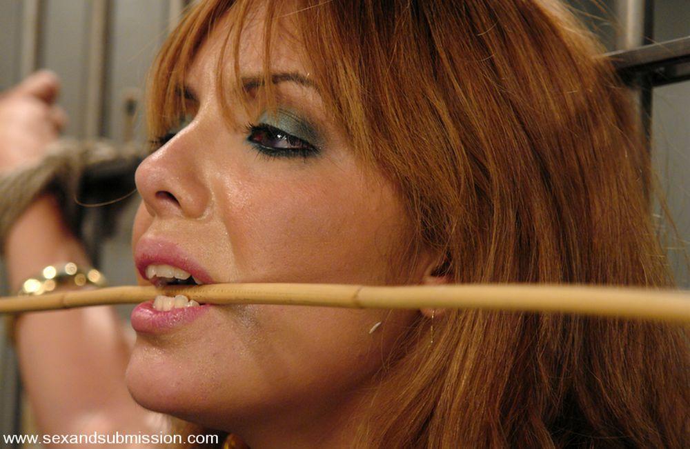 cane between her teeth