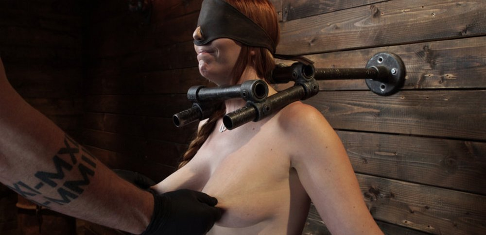 blindfolded bondage cutie grimacing in pain as both her nipples get twisted at Device Bondage
