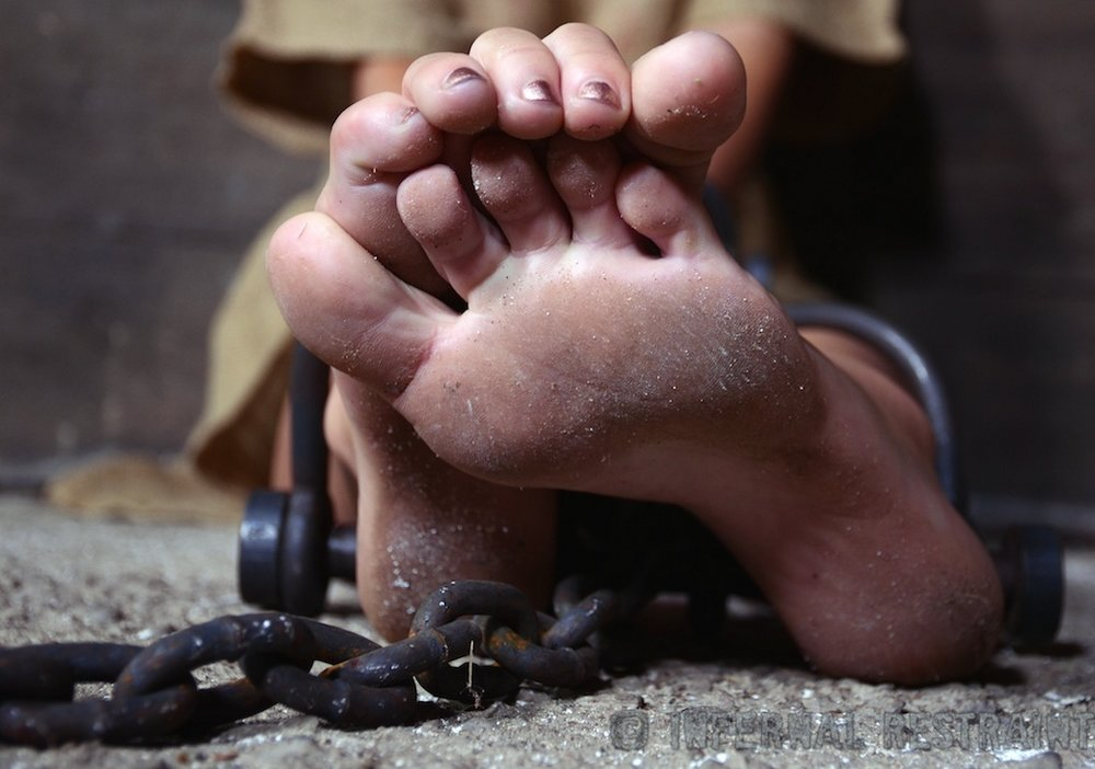 chained in the dungeon of a foot fetishist