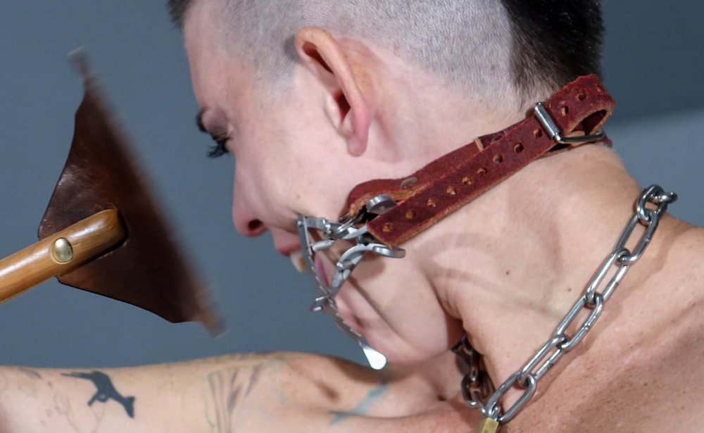 slapping her face with a soft leather riding crop slapper paddle