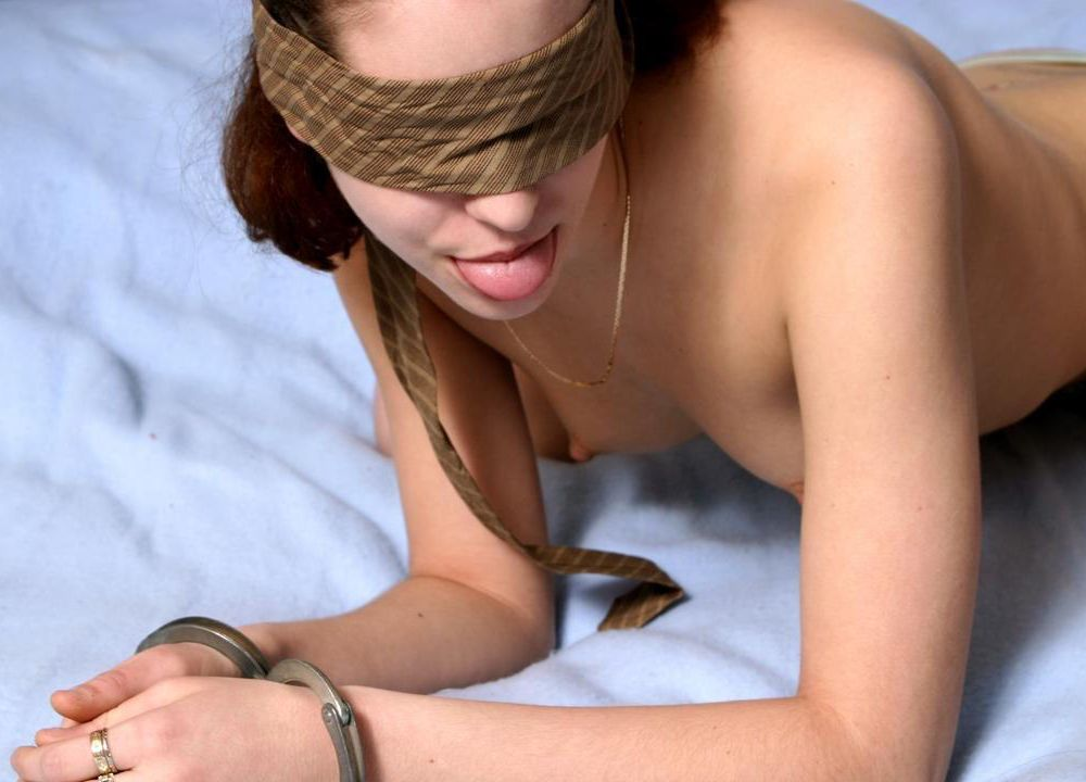 handcuffed woman sticking out her tongue
