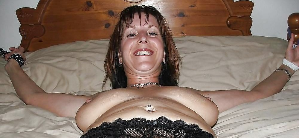 happy milf tied to the bed with neckties