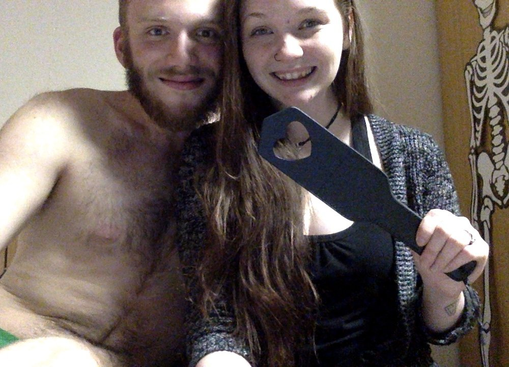 happy couple with spanking paddle