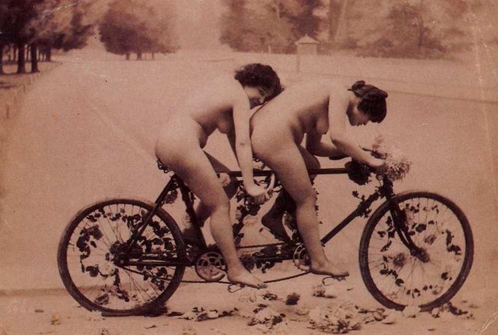 naked lesbians on a tandem bicycle covered in flowers