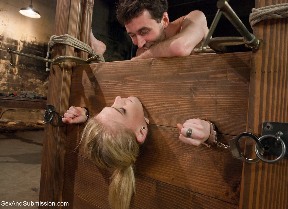 James Deen smiles at Allie James as he fucks her in a bondage bed