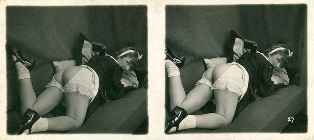 a vintage stereo view card of a woman reclining with her bottom exposed through split knickers